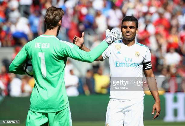 Carlos Henrique Casemiro of Real Madrid congratulates goalie David De Gea of Manchester United after De Gea stopped Casemiro's penalty kick in a...