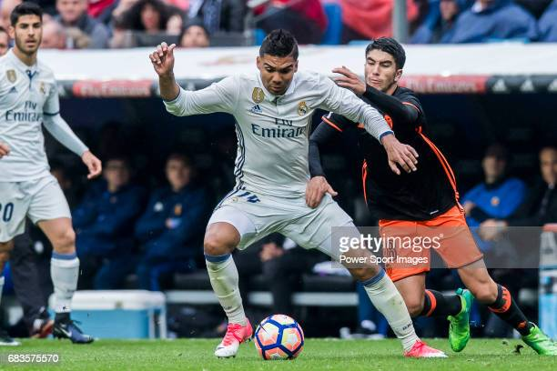 Carlos Henrique Casemiro of Real Madrid fights for the ball with Carlos Soler Barragan of Valencia CF during their La Liga match between Real Madrid...