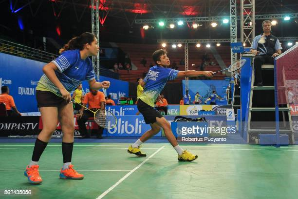 Carlos Henrriquez and Camila Navas of El Salvador compete against Marcus Kong and Maggie Chan of Australia during Mixed Double qualification round of...