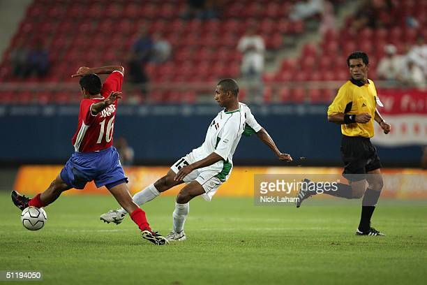 Carlos Hernandez of Costa Rica and Qusai Munir of Iraq in action during the men's football preliminary match on August 15 2004 during the Athens 2004...