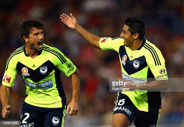Carlos Hernandez and Harry Kewell of the Victory celebrate after Hernandez scored his teams first goal during the round nine ALeague match between...