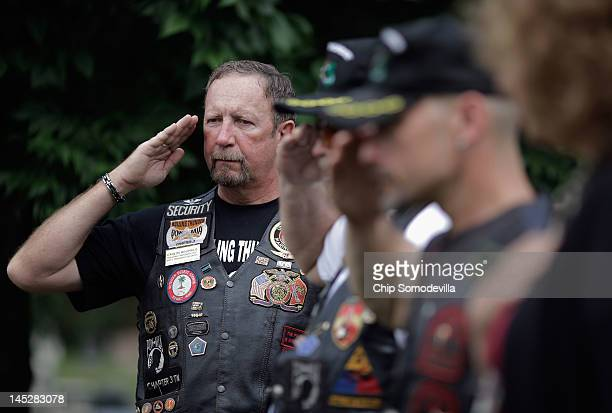 Carlos Hollifield of Knoxville TN who served in the US Marine Corps for 31 years salutes with other veterans during a wreathlaying ceremony at the...