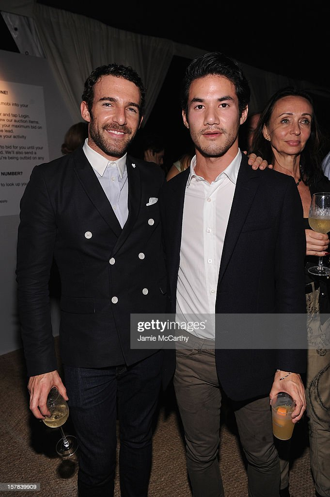 Carlos Huber and Joseph Altuzarrra attend the amfAR Inspiration Miami Beach Party at Soho Beach House on December 6, 2012 in Miami Beach, Florida.
