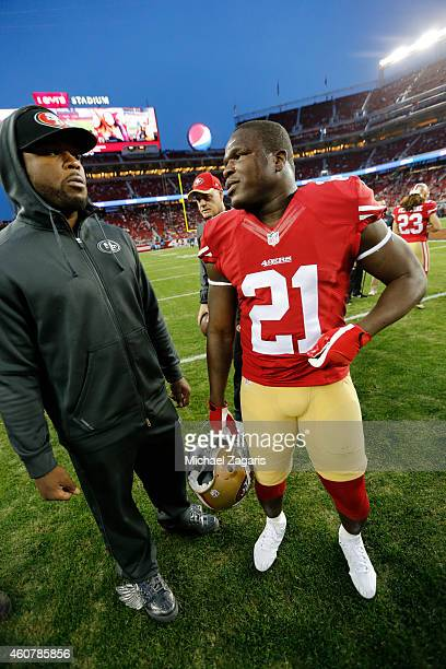 Carlos Hyde and Frank Gore of the San Francisco 49ers stand on the field prior to the game against the San Diego Chargers at Levi Stadium on December...