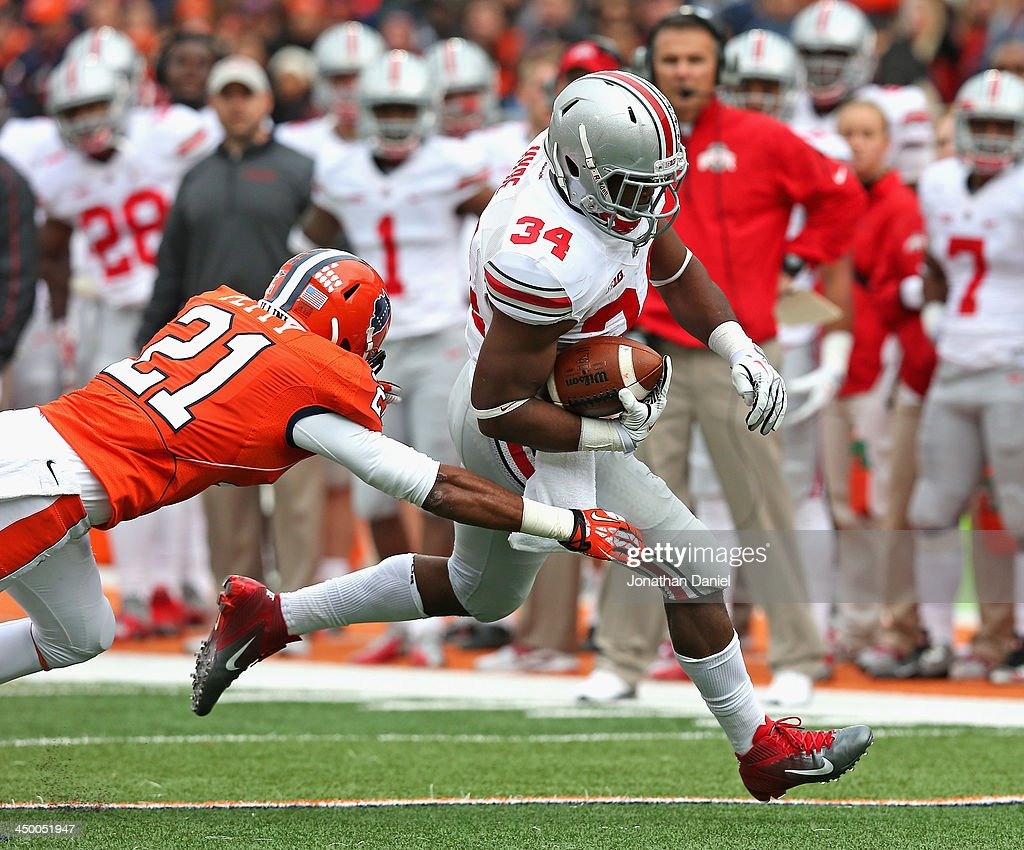 Carlos Hyde #34 of the Ohio State Buckeyes breaks a tackle attempt by Zane Petty #21 of the Illinois Fighting Illini to score a touchdown at Memorial Stadium on November 16, 2013 in Champaign, Illinois.