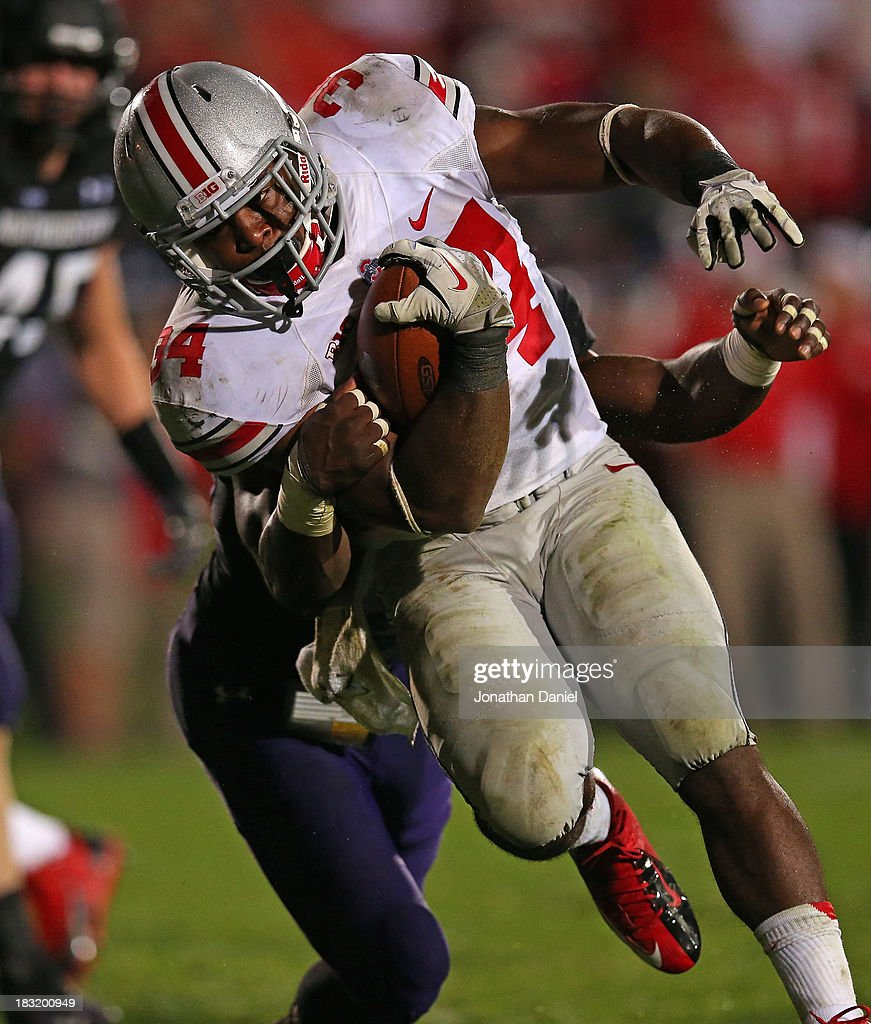 Carlos Hyde #34 of the Ohio State Buckeyes breaks away from Traveon Henry #10 of the Northwestern Wilcats to score a second half touchdown at Ryan Field on October 5, 2013 in Evanston, Illinois. Ohio State defeated Northwestern 40-30.