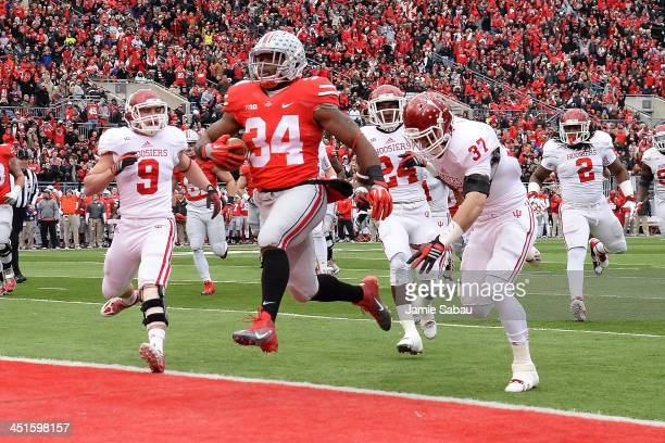 Carlos Hyde of the Ohio State Buckeyes completes a 16yard run for a touchdown in the first quarter against the Indiana Hoosiers at Ohio Stadium on...