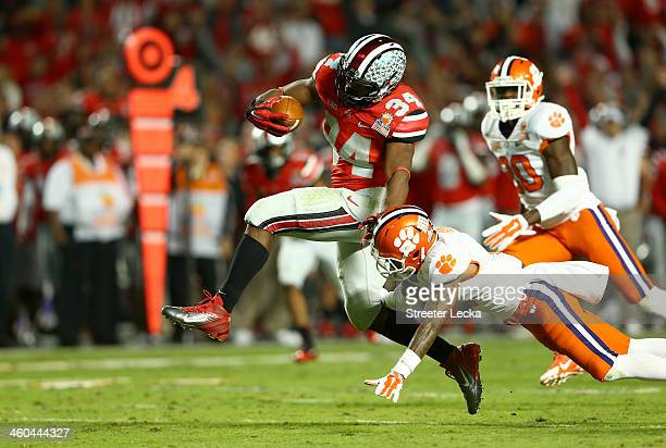 Carlos Hyde of the Ohio State Buckeyes runs with the ball in the third quarter against the Clemson Tigers during the Discover Orange Bowl at Sun Life...
