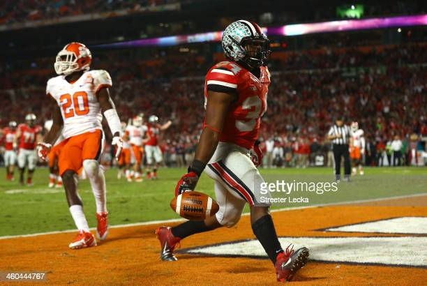 Carlos Hyde of the Ohio State Buckeyes scores a touchdown in the fourth quarter against the Clemson Tigers during the Discover Orange Bowl at Sun...