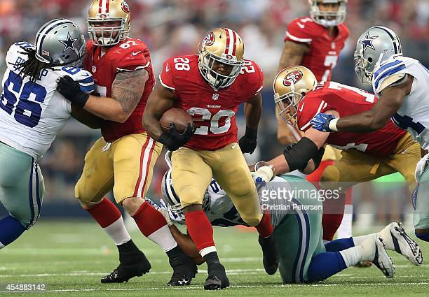Carlos Hyde of the San Francisco 49ers carries the ball against the Dallas Cowboys in the second half at ATT Stadium on September 7 2014 in Arlington...