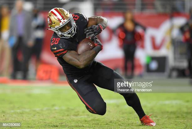 Carlos Hyde of the San Francisco 49ers carries the ball against the Los Angeles Rams during their NFL football game at Levi's Stadium on September 21...