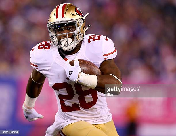 Carlos Hyde of the San Francisco 49ers carries the ball in the first quarter against the New York Giants during at MetLife Stadium on October 11 2015...