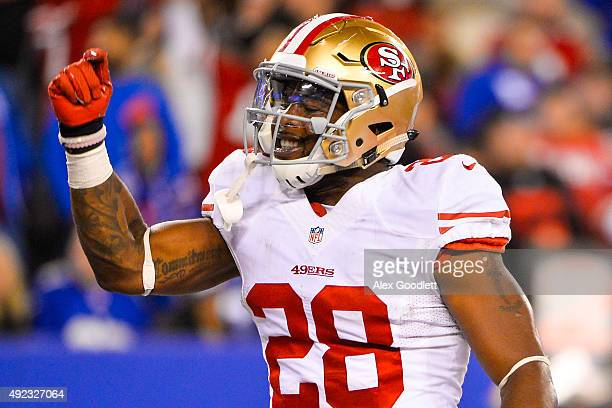 Carlos Hyde of the San Francisco 49ers celebrates a touchdown in the fourth quarter during a game against the New York Giants at MetLife Stadium on...