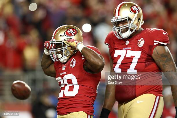 Carlos Hyde of the San Francisco 49ers celebrates after scoring in the fourth quarter against the Los Angeles Rams during their NFL game at Levi's...