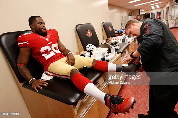Carlos Hyde of the San Francisco 49ers gets his foot taped up in the locker room prior to the game against the Seattle Seahawks at Levi Stadium on...