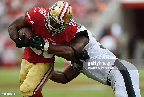 Carlos Hyde of the San Francisco 49ers gets tackled by Malcolm Jenkins of the Philadelphia Eagles during the fourth quarter at Levi's Stadium on...