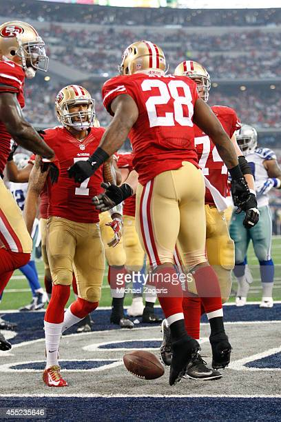 Carlos Hyde of the San Francisco 49ers is congratulated by Colin Kaepernick after scoring a touchdown during the game against the Dallas Cowboys at...
