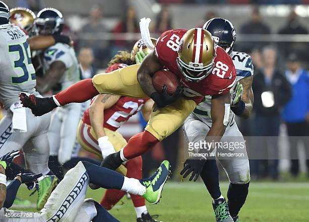 Carlos Hyde of the San Francisco 49ers leaves the ground from a tackle from Earl Thomas of the Seattle Seahawks in the third quarter at Levi's...