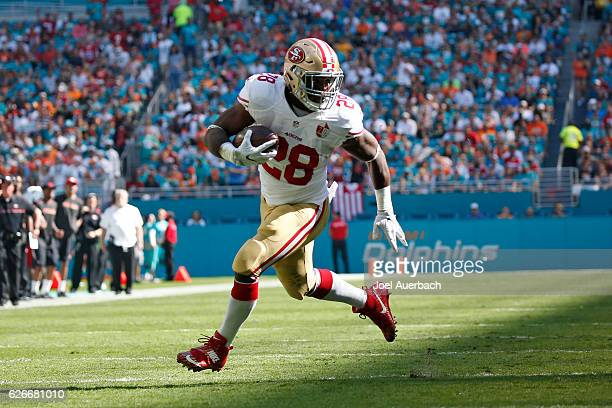 Carlos Hyde of the San Francisco 49ers looks back as he runs for a first quarter touchdown against the Miami Dolphins on November 27 2016 at Hard...