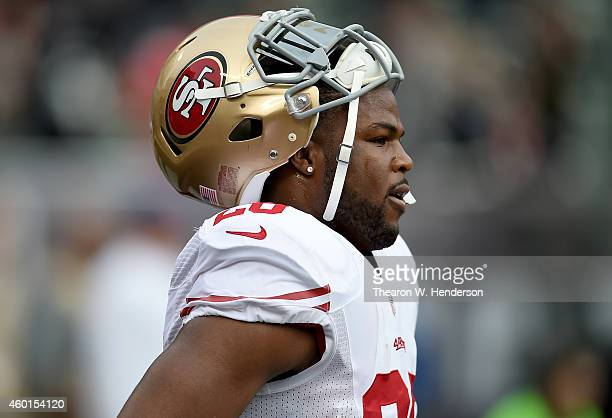 Carlos Hyde of the San Francisco 49ers looks on during pregame warm ups prior to playing the Oakland Raiders at Oco Coliseum on December 7 2014 in...