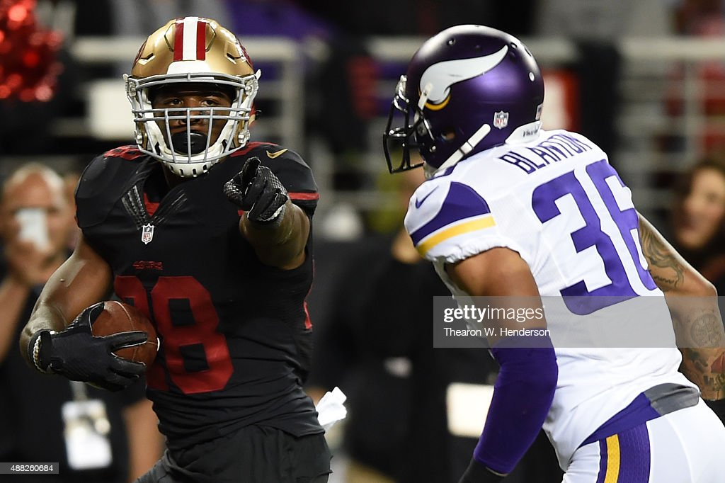 Carlos Hyde #28 of the San Francisco 49ers points at Robert Blanton #36 of the Minnesota Vikings as he runs for a touchdown during their NFL game at Levi's Stadium on September 14, 2015 in Santa Clara, California.