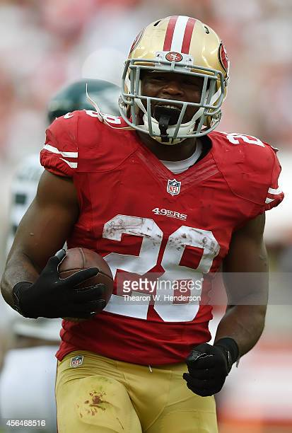 Carlos Hyde of the San Francisco 49ers reacts after he was tackled by Malcolm Jenkins of the Philadelphia Eagles during the fourth quarter at Levi's...