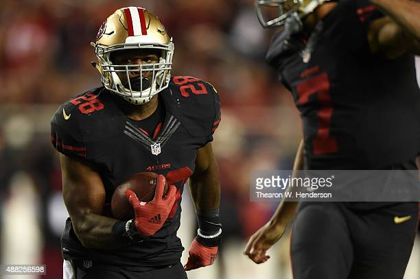 Carlos Hyde of the San Francisco 49ers runs for a touchdown against the Minnesota Vikings in the second quarter of their NFL game at Levi's Stadium...