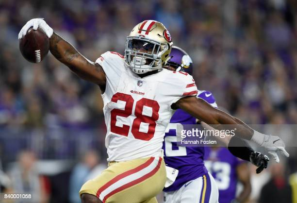 Carlos Hyde of the San Francisco 49ers runs the ball in for a touchdown against the Minnesota Vikings during the second quarter in the preseason game...