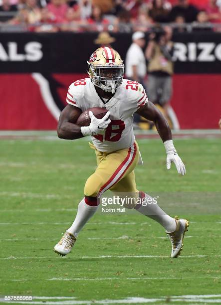 Carlos Hyde of the San Francisco 49ers runs with the ball against the Arizona Cardinals at University of Phoenix Stadium on October 1 2017 in...