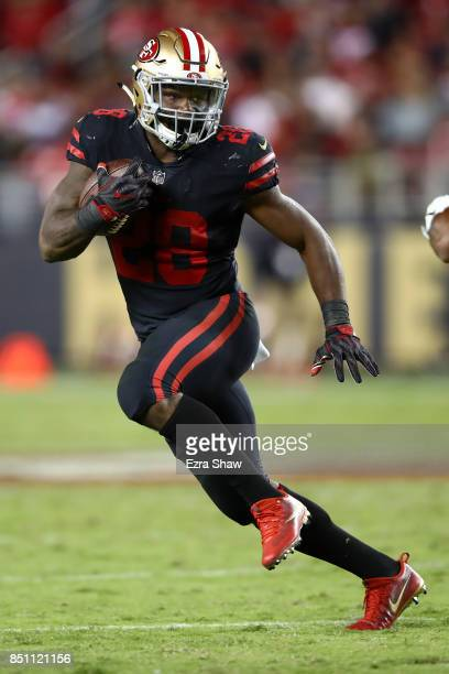 Carlos Hyde of the San Francisco 49ers rushes against the Los Angeles Rams during their NFL game at Levi's Stadium on September 21 2017 in Santa...