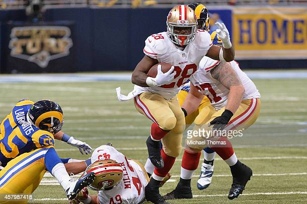 Carlos Hyde of the San Francisco 49ers rushes against the St Louis Rams at the Edward Jones Dome on October 13 2014 in St Louis Missouri