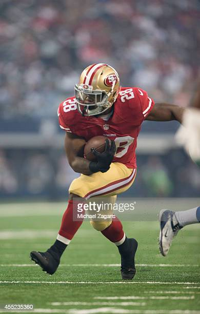 Carlos Hyde of the San Francisco 49ers rushes during the game against the Dallas Cowboys at ATT Stadium on September 7 2014 in Arlington Texas The...