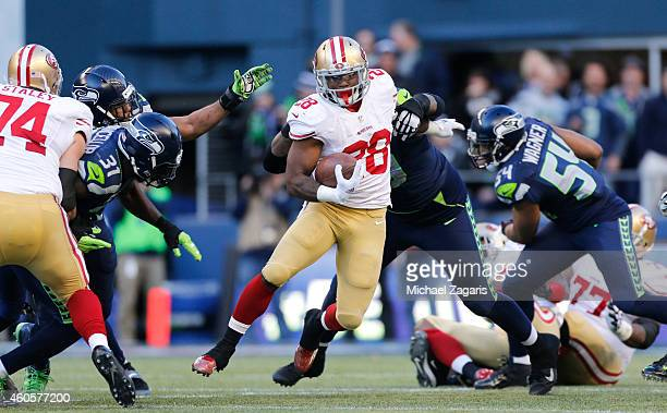 Carlos Hyde of the San Francisco 49ers rushes during the game against the Seattle Seahawks at CenturyLink Field on December 14 2014 in Seattle...