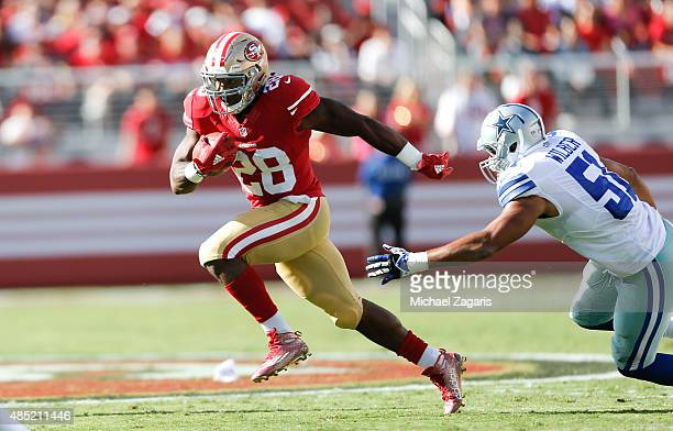Carlos Hyde of the San Francisco 49ers rushes during the game against the Dallas Cowboys at Levi Stadium on August 23 2015 in Santa Clara California...