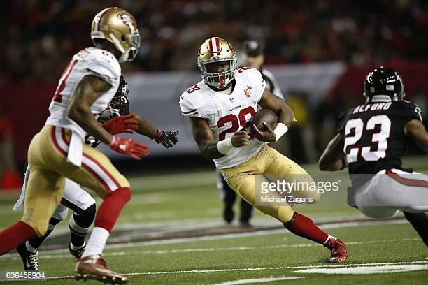 Carlos Hyde of the San Francisco 49ers rushes during the game against the Atlanta Falcons at the Georgia Dome on December 18 2016 in Atlanta Georgia...