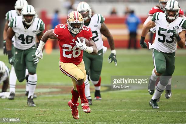 Carlos Hyde of the San Francisco 49ers rushes with the ball against the New York Jets during their NFL game at Levi's Stadium on December 11 2016 in...