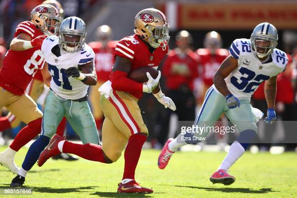 Carlos Hyde of the San Francisco 49ers rushes with the ball against the Dallas Cowboys during their NFL game at Levi's Stadium on October 22 2017 in...