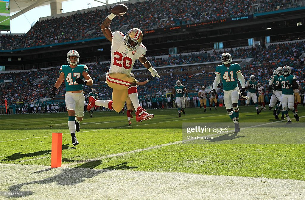Carlos Hyde #28 of the San Francisco 49ers scores a touchdown during a game against the Miami Dolphins on November 27, 2016 in Miami Gardens, Florida.