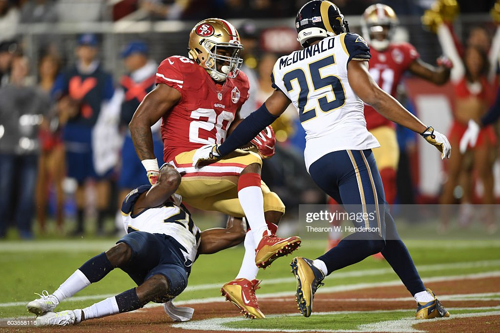 Carlos Hyde #28 of the San Francisco 49ers scores a touchdown on a 11-yard run against the Los Angeles Rams during their NFL game at Levi's Stadium on September 12, 2016 in Santa Clara, California.