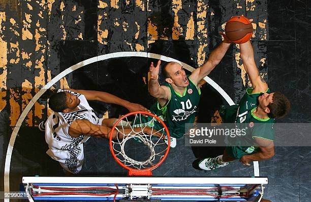 Carlos Jimenez #10 of Unicaja competes with Joel Freeland #19 of Unicaja in action during the Euroleague Basketball Regular Season 20092010 Game Day...