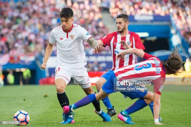 Carlos Joaquin Correa of Sevilla FC competes for the ball with Filipe Luis and Jorge Resurreccion Merodio Koke of Atletico de Madrid during their La...
