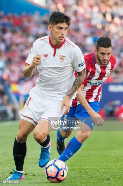 Carlos Joaquin Correa of Sevilla FC competes for the ball with Jorge Resurreccion Merodio Koke of Atletico de Madrid during their La Liga match...