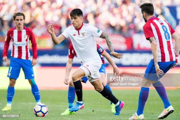 Carlos Joaquin Correa of Sevilla FC is challenged by Atletico de Madrid's players during their La Liga match between Atletico de Madrid and Sevilla...
