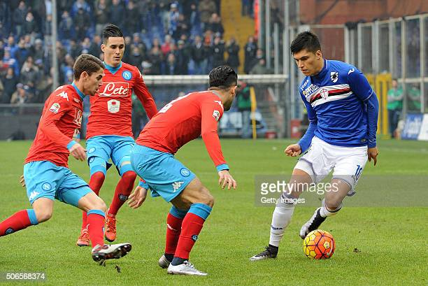 Carlos Joaquin Correa of UC Sampdoria is surrounded by Napoli players during the Serie A match between UC Sampdoria and SSC Napoli at Stadio Luigi...