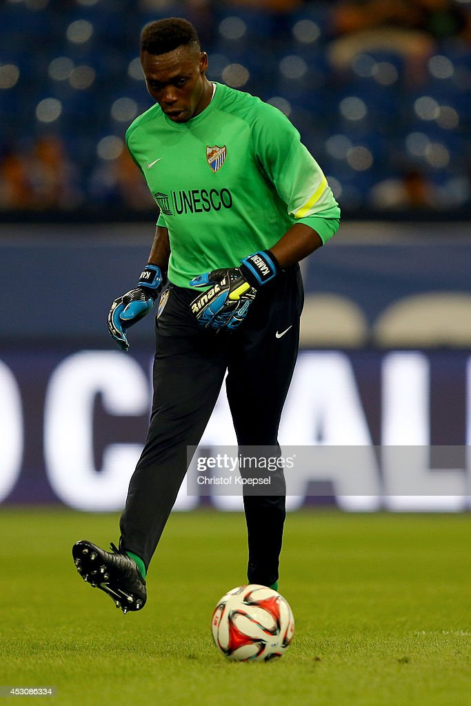 Carlos Kameni of Malaga kicks the ball during the match between FC Malaga and Newcastle United as part of the Schalke 04 Cup Day at Veltins-Arena on August 2, 2014 in Gelsenkirchen, Germany.