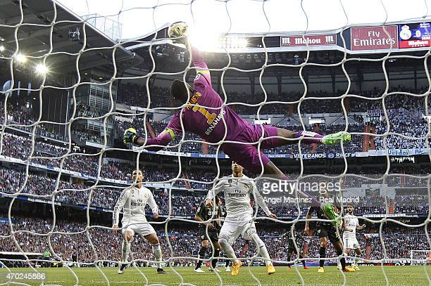Carlos Kameni of Malaga makes a save during the La Liga match between Real Madrid CF and Malaga at Estadio Santiago Bernabeu on April 18 2015 in...