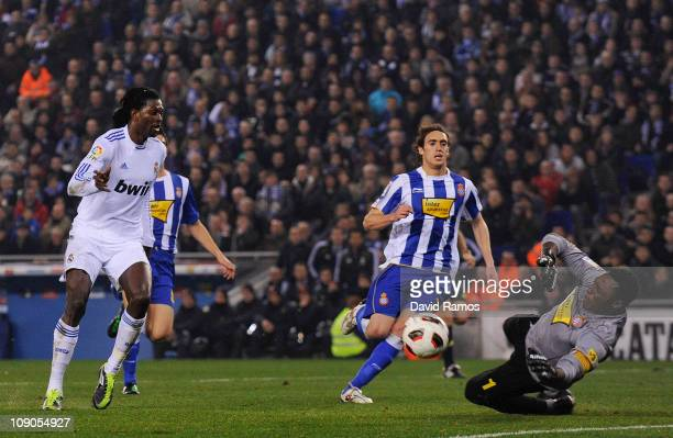 Carlos Kameni of RCD Espanyol blocks a shoot made by Emmanuel Adebayor of Real Madrid during La Liga match between RCD Espanyol and Real Madrid at...