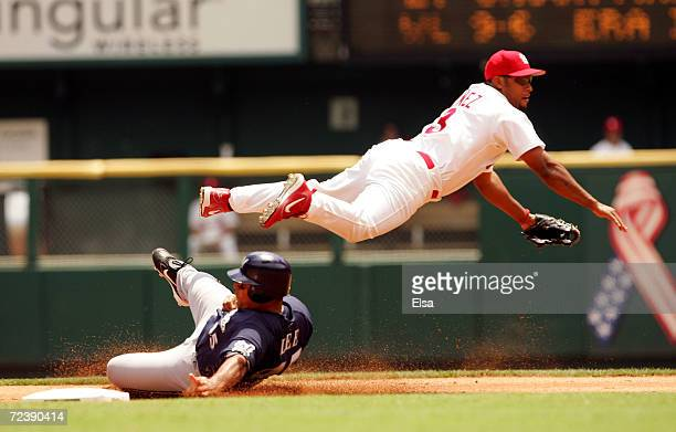 Carlos Lee of the Milwaukee Brewers is out at second as Abraham Nunez of the St Louis Cardinals makes the double play on July 21 2005 at Busch...