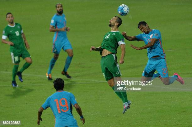 Carlos Leonel Fernandes of Macau and Narayan Das of India head the ball during the 2019 AFCAsian Cup qualifying match between India and Macau held at...