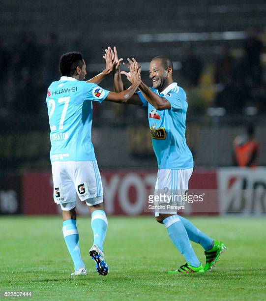 Carlos Lobaton and Alberto Rodriguez of Sporting Cristal celebrate the first goal of their team during a match between Penarol and Sporting Cristal...